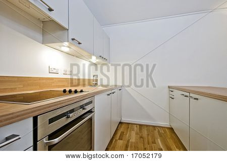 contemporary kitchen in white with wooden worktop