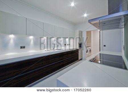 amazing penthouse kitchen with white stone worktop