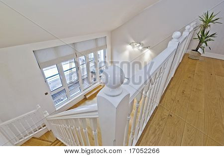 view from a top floor of a split level living room