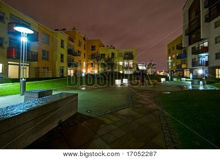 night shot of a modern developments communal garden