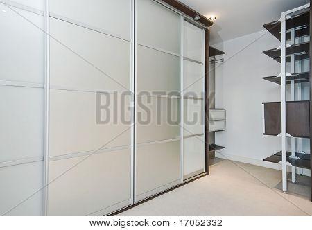 walk in wardrobe with large slide door shrinks and shelf storage