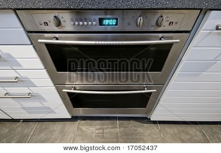 modern domestic stainless steel electric oven with digital display