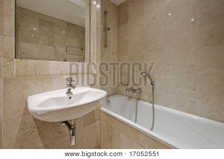 modern luxury bathroom with beige marble tiles and white ceramic suite