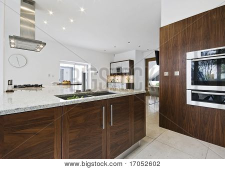 contemporary luxury kitchen with working isle and granite worktop
