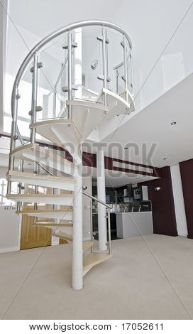 metal construction spiral staircase in a duplex apartment