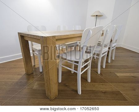 massive retro dining table with six white wooden chairs