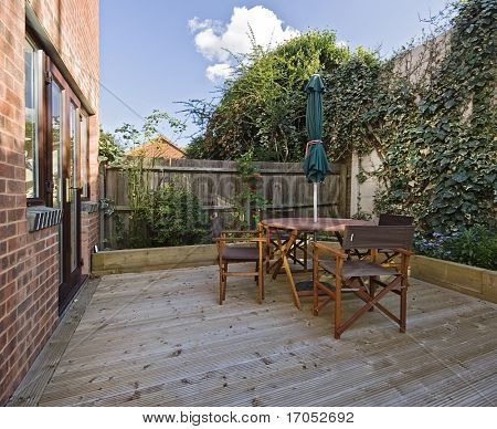 terrace with hard wood deck floor and garden furniture