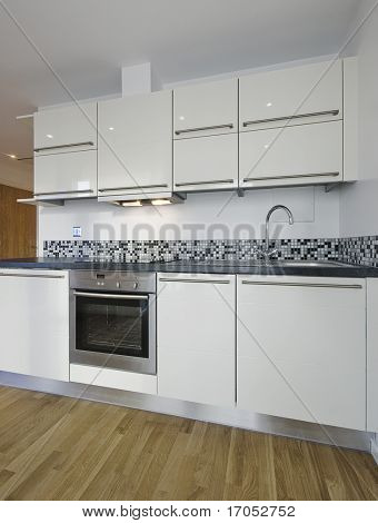 contemporary kitchen counter with decorative mosaic tiles