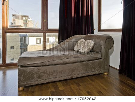 detail of psychiatrist sofa in a room with floor to ceiling window