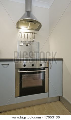 kitchen counter detail with oven and stainless steel extractor fan