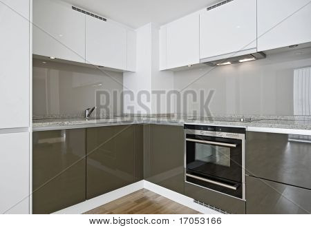 modern kitchen corner unit with granite stone worktop
