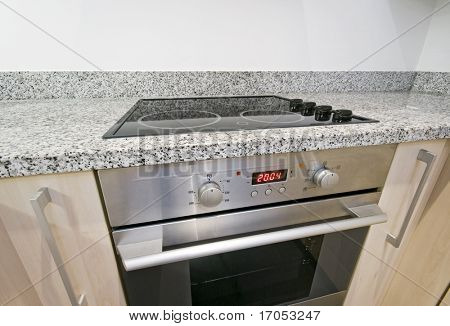 modern electric hob and oven detail shot