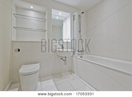 modern bright bathroom with beige mosaic tiles
