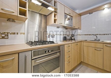 modern kitchen with hard wood unit and worktop