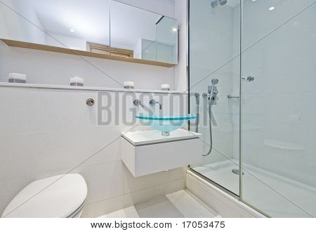 luxury designer en-suite bathroom with shower cabin and glass bowl hand wash basin