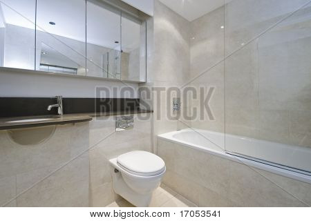 luxury bathroom with beige floor to ceiling marble tiles