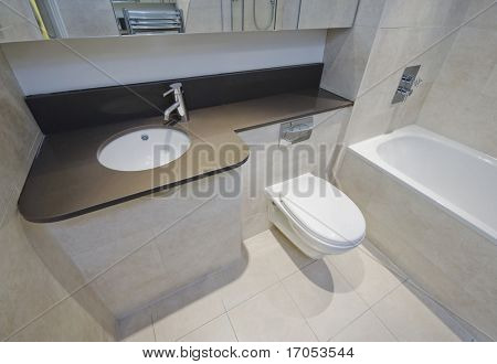 modern luxury bathroom detail with beige marble tiles