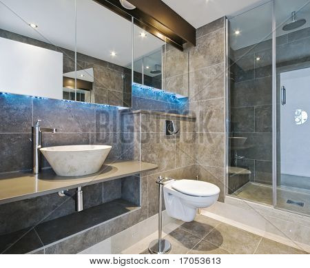 baño de lujo con piedra lavabo de colada de la mano