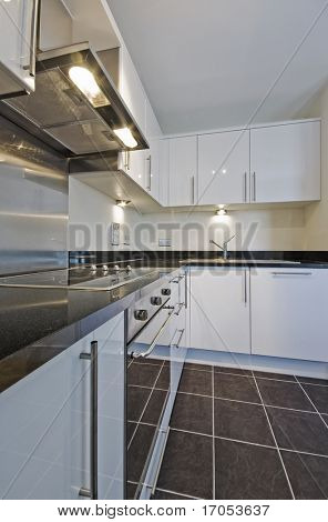 modern white kitchen unit with granite worktop