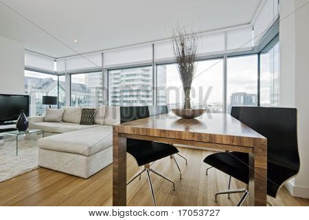 massive luxury living room with floor to ceiling windows and city views