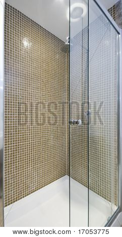 modern luxury shower corner with glass slide door and mosaic tiles