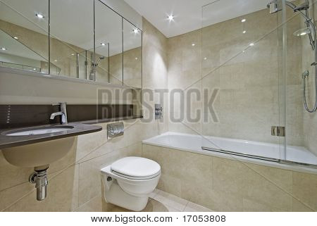 modern bathroom with three piece suite and floor to ceiling marble tiles
