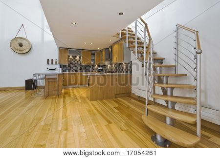 modern open plan kitchen in a designer apartment with mezzanine