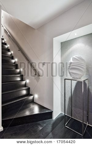 modern wooden staircase with discrete floor lighting