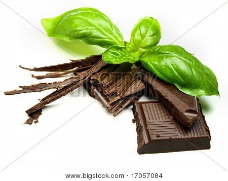 Delicious chocolate with sweet basil isolated on white background