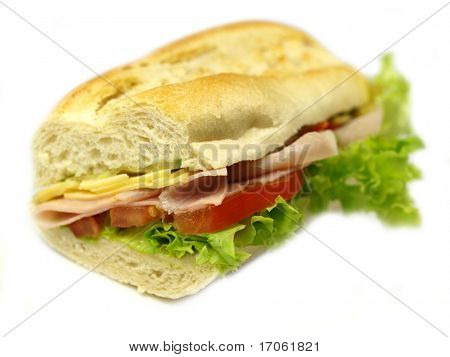 Sandwich with ham and vegetables on white background