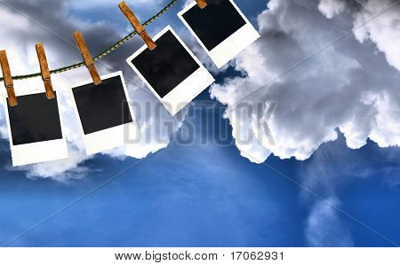 Photo frames with cloudy sky background