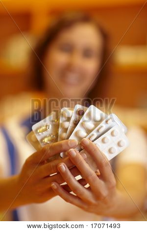 Woman Showing Pills