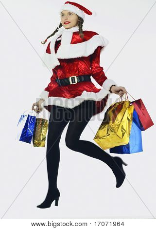 young funny and expressive woman dressed as santa claus is doing her shopping
