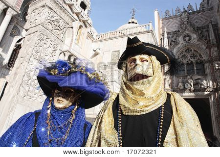 wonderful fashion show of disguised people during the venice carnival in italy (the effect is not a photoshop trick)