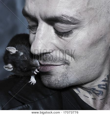 portrait studio on isolated background of a strange man with his rat