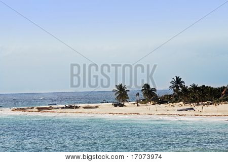 view of the beautiful white sand beach of tulum in yucatan mexico