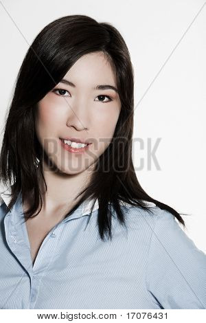 studio shot portrait of a beautiful southeast asian young woman smilin