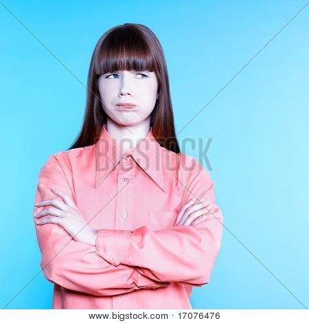 studio portrait of a young woman boredom on isolated background