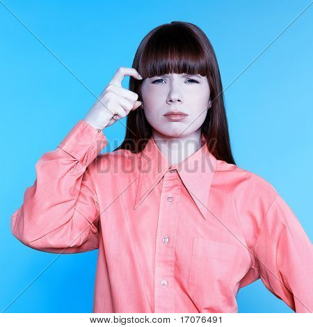 studio portrait of a young woman on isolated background gesturing bad moo