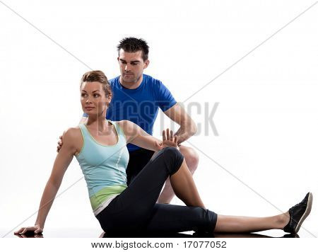 couple, man and woman on Abdominals rotation workout posture on white background.
