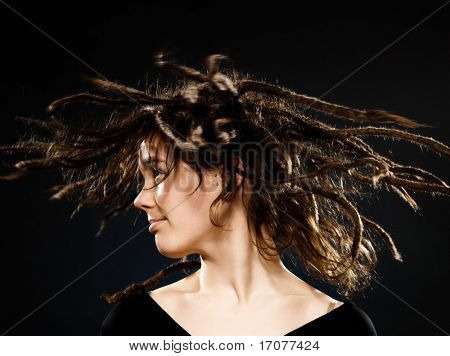 studio shot portraits of a young blond caucasian woman with dreadlocks on black background