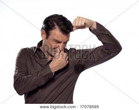 man perspiring unpleasant smell isolated studio on white background