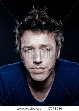 studio portrait on black background of a funny expressive caucasian man aslee