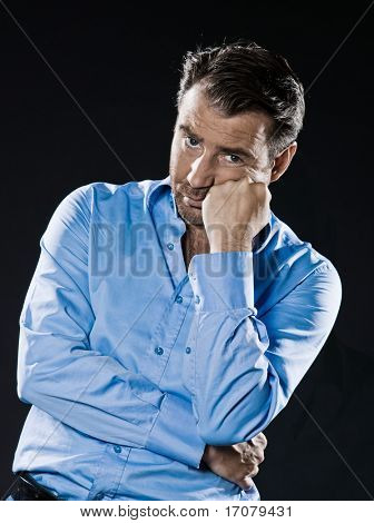 caucasian man unshaven sulk bored portrait isolated studio on black background