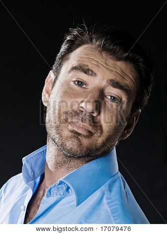 caucasian man unshaven arrogant portrait isolated studio on black background