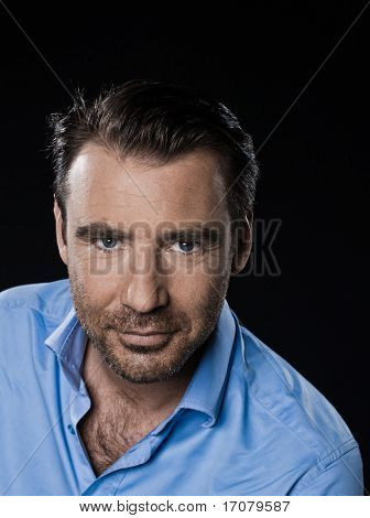 caucasian man unshaven portrait smiling cheerful isolated studio on black background
