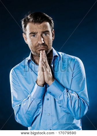 caucasian man unshaven begging despair portrait isolated studio on black background
