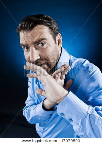 caucasian man hide afraid unshaven portrait isolated studio on black background