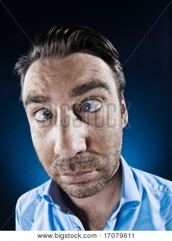 caucasian man unshaven squinting eye problem portrait isolated studio on black background