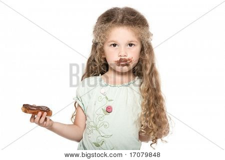 caucasian little girl portrait eat chocolate grubby isolated studio on white background